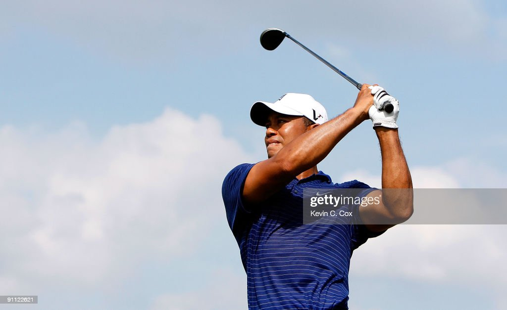<a gi-track='captionPersonalityLinkClicked' href=/galleries/search?phrase=Tiger+Woods&family=editorial&specificpeople=157537 ng-click='$event.stopPropagation()'>Tiger Woods</a> tees off the seventh hole during the first round of THE TOUR Championship presented by Coca-Cola, the final event of the PGA TOUR Playoffs for the FedExCup, at East Lake Golf Club on September 24, 2009 in Atlanta, Georgia.