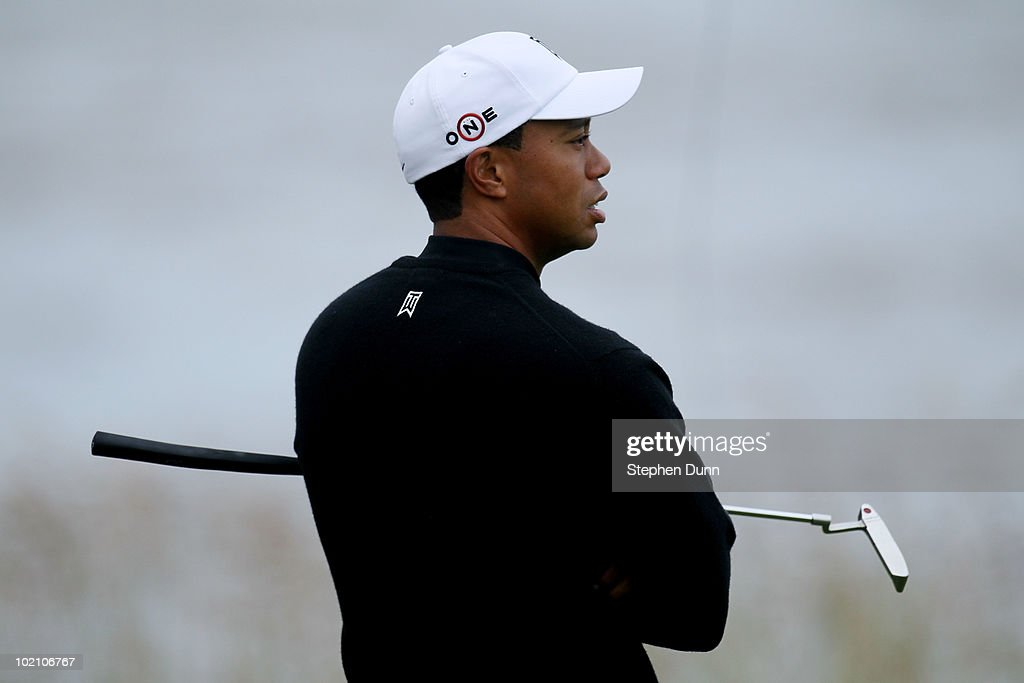 Tiger Woods waits on a green during a practice round prior to the start of the 110th U.S. Open at Pebble Beach Golf Links on June 15, 2010 in Pebble Beach, California.