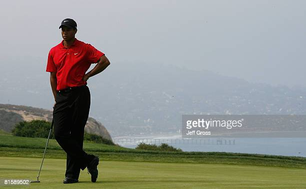 Tiger Woods waits on the fourth hole during the playoff round of the 108th US Open at the Torrey Pines Golf Course on June 16 2008 in San Diego...