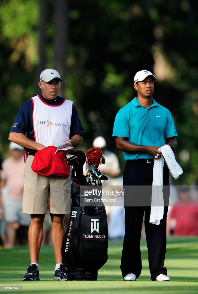 Tiger Woods (R) waits on the tenth fairway with caddie Steve Williams during the second round of THE PLAYERS Championship held at THE PLAYERS Stadium course at TPC Sawgrass on May 7, 2010 in Ponte Vedra Beach, Florida.