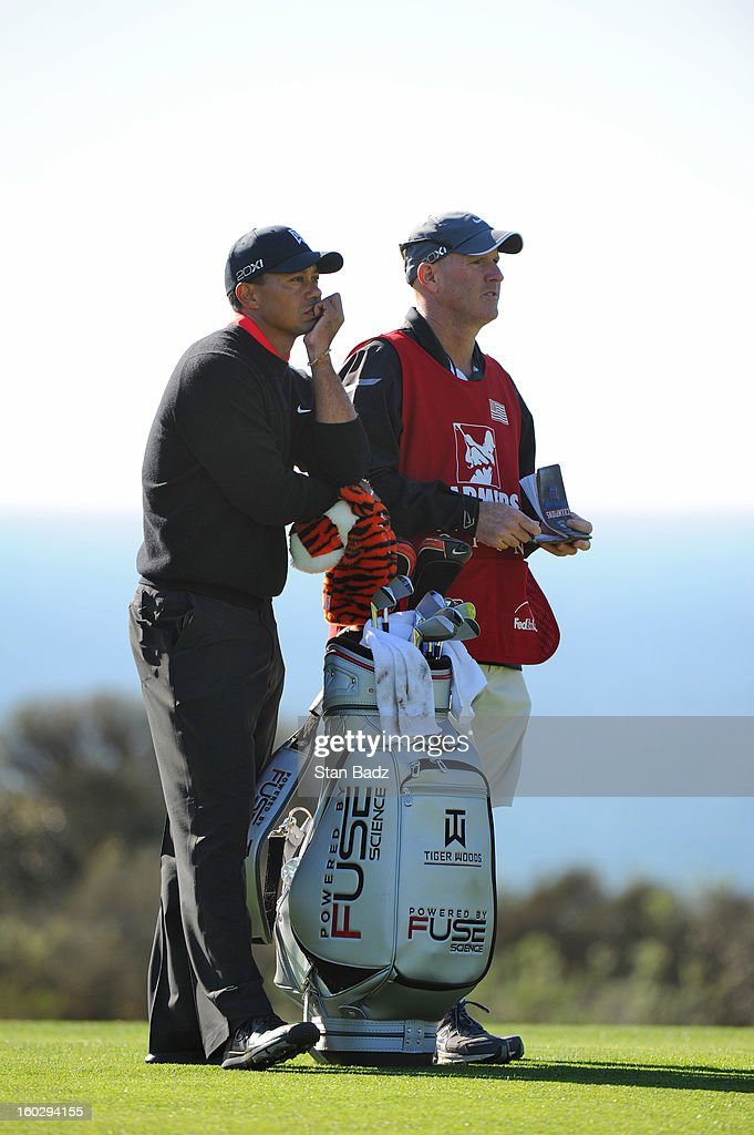 Tiger Woods waits to play the 17th hole during the final round of the Farmers Insurance Open at Torrey Pines Golf Course on January 28, 2013 in La Jolla, California.