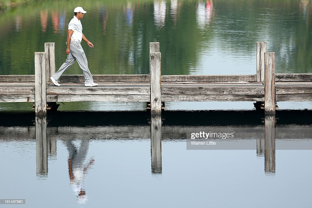 <a gi-track='captionPersonalityLinkClicked' href=/galleries/search?phrase=Tiger+Woods&family=editorial&specificpeople=157537 ng-click='$event.stopPropagation()'>Tiger Woods</a> walks across a foot bridge towards the fourth hole tee box during the second round of the BMW Championship at Crooked Stick Golf Club on September 7, 2012 in Carmel, Indiana.