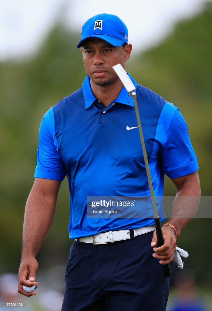 <a gi-track='captionPersonalityLinkClicked' href=/galleries/search?phrase=Tiger+Woods&family=editorial&specificpeople=157537 ng-click='$event.stopPropagation()'>Tiger Woods</a> walks across a green during the first round of the World Golf Championships-Cadillac Championship at Trump National Doral on March 6, 2014 in Doral, Florida.