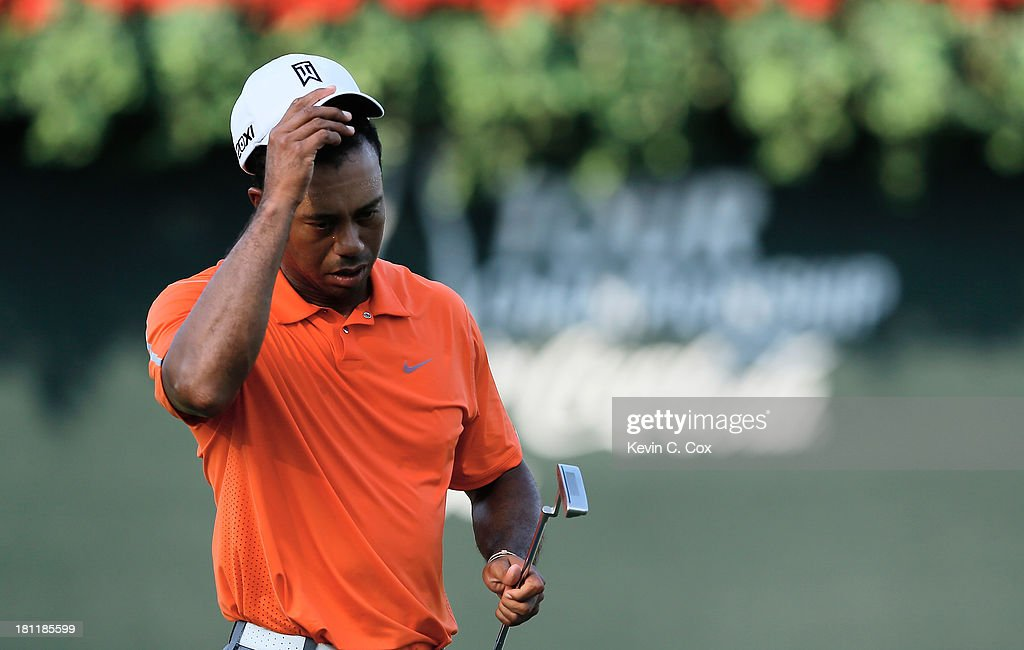 <a gi-track='captionPersonalityLinkClicked' href=/galleries/search?phrase=Tiger+Woods&family=editorial&specificpeople=157537 ng-click='$event.stopPropagation()'>Tiger Woods</a> walks across the 18th green after a three-over par 73 during the first round of the TOUR Championship by Coca-Cola at East Lake Golf Club on September 19, 2013 in Atlanta, Georgia.