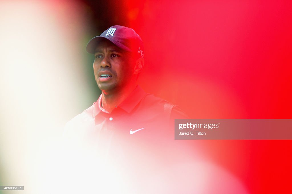 Tiger Woods walks off of the second tee box during the final round of the Wyndham Championship at Sedgefield Country Club on August 23, 2015 in Greensboro, North Carolina.