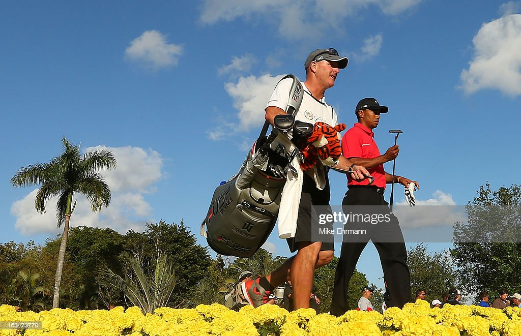 Tiger Woods walks off the 15th tee alongside his caddie Joe LaCava during the final round of the World Golf Championships-Cadillac Championship at the Trump Doral Golf Resort & Spa on March 10, 2013 in Doral, Florida.