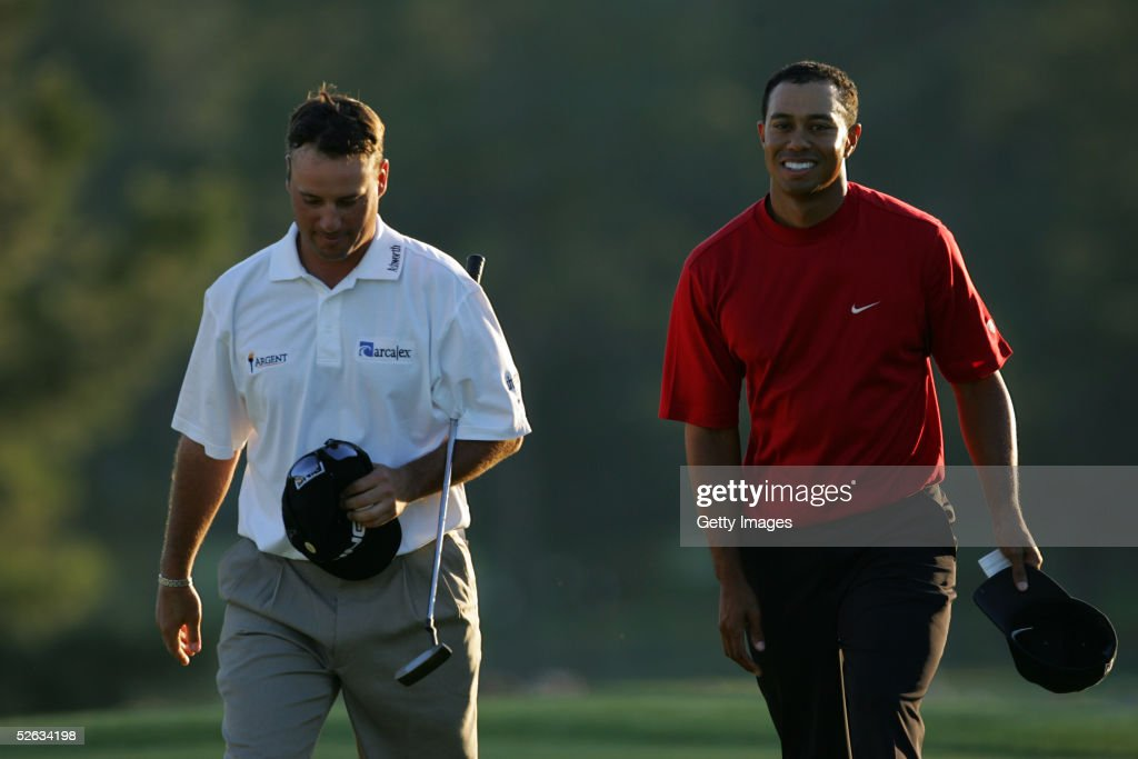 <a gi-track='captionPersonalityLinkClicked' href=/galleries/search?phrase=Tiger+Woods&family=editorial&specificpeople=157537 ng-click='$event.stopPropagation()'>Tiger Woods</a> walks off the 18th green with Chris DiMarco after sinking a putt on the first playoff hole to win the 2005 Masters on April 10, 2005 at Augusta National Golf Course in Augusta, Georgia.