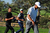 Tiger Woods walks off the course after withdrawing from the Farmers Insurance Open due to injury at Torrey Pines Golf Course on February 5 2015 in La...