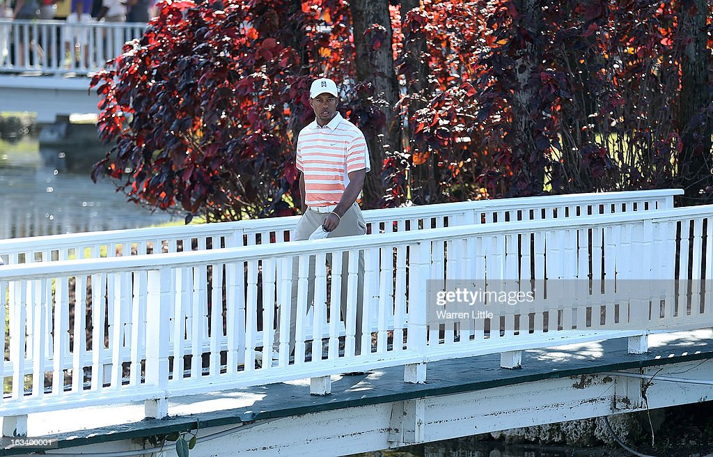 <a gi-track='captionPersonalityLinkClicked' href=/galleries/search?phrase=Tiger+Woods&family=editorial&specificpeople=157537 ng-click='$event.stopPropagation()'>Tiger Woods</a> walks off the ninth hole during the second round of the World Golf Championships-Cadillac Championship at the Trump Doral Golf Resort & Spa on March 8, 2013 in Doral, Florida.