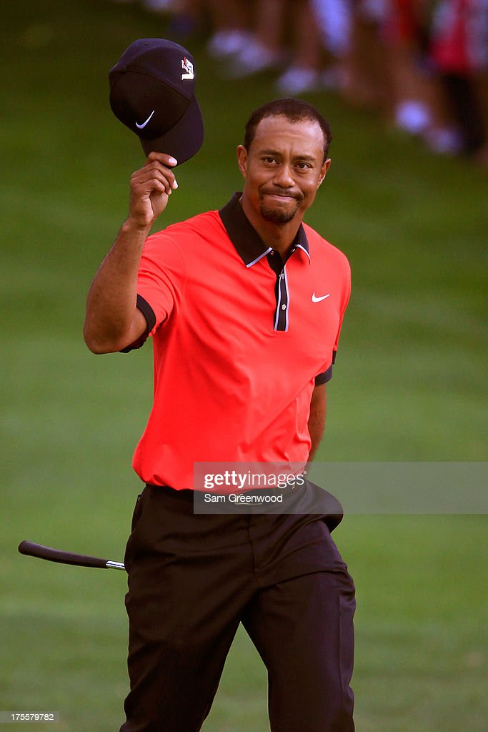 Tiger Woods walks onto the 18th green during the Final Round of the World Golf Championships-Bridgestone Invitational at Firestone Country Club South Course on August 4, 2013 in Akron, Ohio.
