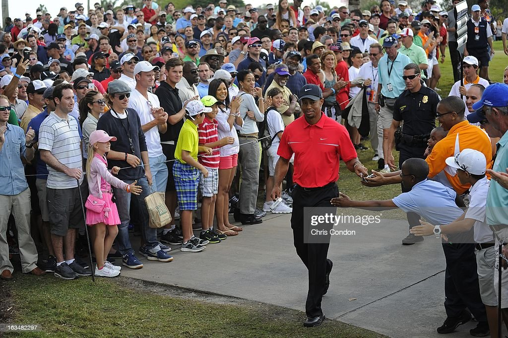 Tiger Woods walks to the 12th tee during the final round of the World Golf Championships-Cadillac Championship at TPC Blue Monster at Doral on March 10, 2013 in Doral, Florida.