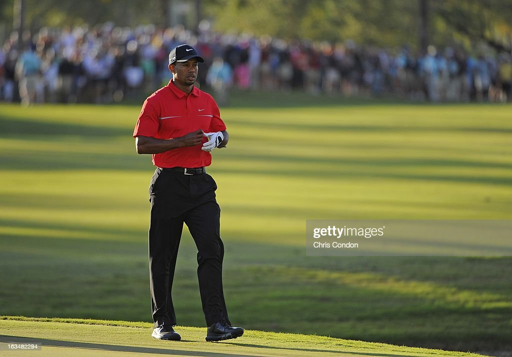 Tiger Woods walks to the 18th green during the final round of the World Golf Championships-Cadillac Championship at TPC Blue Monster at Doral on March 10, 2013 in Doral, Florida.