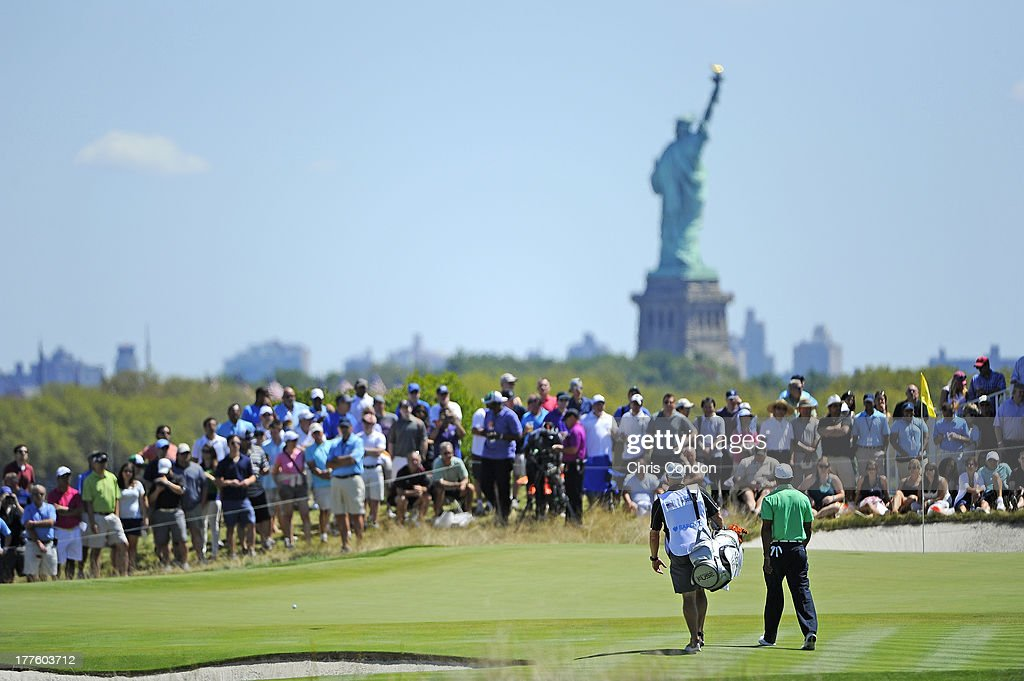 Tiger Woods walks to the second green during the third round of The Barclays at Liberty National Golf Club on August 24 2013 in Jersey City New Jersey