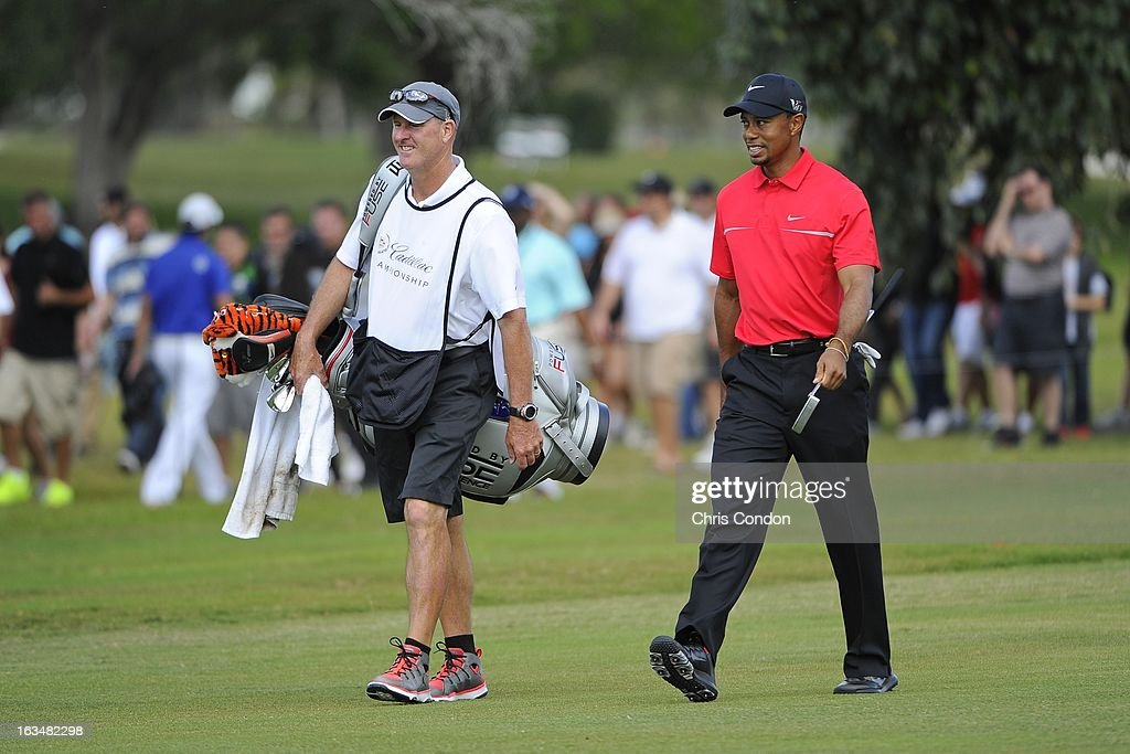 Tiger Woods walks up the 7th fairway during the final round of the World Golf Championships-Cadillac Championship at TPC Blue Monster at Doral on March 10, 2013 in Doral, Florida.
