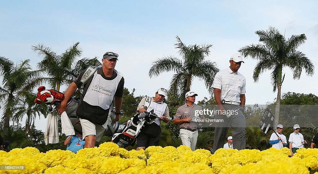 Tiger Woods walks with his caddie Joe LaCava ahead of Graeme McDowell of Northern Ireland and his caddie Ken Comboy on the 15th hole during the third round of the World Golf Championships-Cadillac Championship at the Trump Doral Golf Resort & Spa on March 9, 2013 in Doral, Florida.