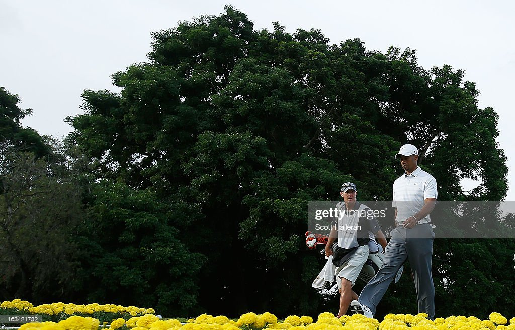 Tiger Woods walks with his caddie Joe LaCava on the 15th hole during the third round of the World Golf Championships-Cadillac Championship at the Trump Doral Golf Resort & Spa on March 9, 2013 in Doral, Florida.