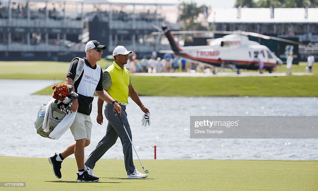 Tiger Woods walks with his caddie Joe LaCava on the tenth hole during the second round of the World Golf Championships-Cadillac Championship at Trump National Doral on March 7, 2014 in Doral, Florida.