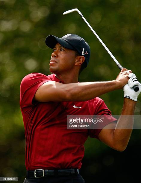 Tiger Woods watches a shot on the fifth hole during the final round of THE TOUR Championship presented by CocaCola the final event of the PGA TOUR...