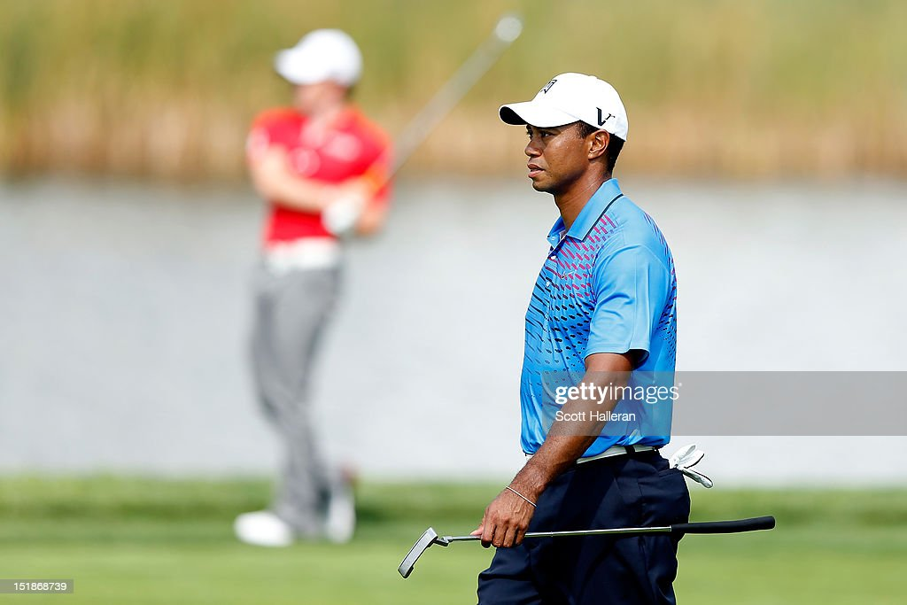 <a gi-track='captionPersonalityLinkClicked' href=/galleries/search?phrase=Tiger+Woods&family=editorial&specificpeople=157537 ng-click='$event.stopPropagation()'>Tiger Woods</a> (R) watches an approach shot hit by <a gi-track='captionPersonalityLinkClicked' href=/galleries/search?phrase=Rory+McIlroy&family=editorial&specificpeople=783109 ng-click='$event.stopPropagation()'>Rory McIlroy</a> of Northern Ireland during the first round of the BMW Championship at Crooked Stick Golf Club on September 6, 2012 in Carmel, Indiana.