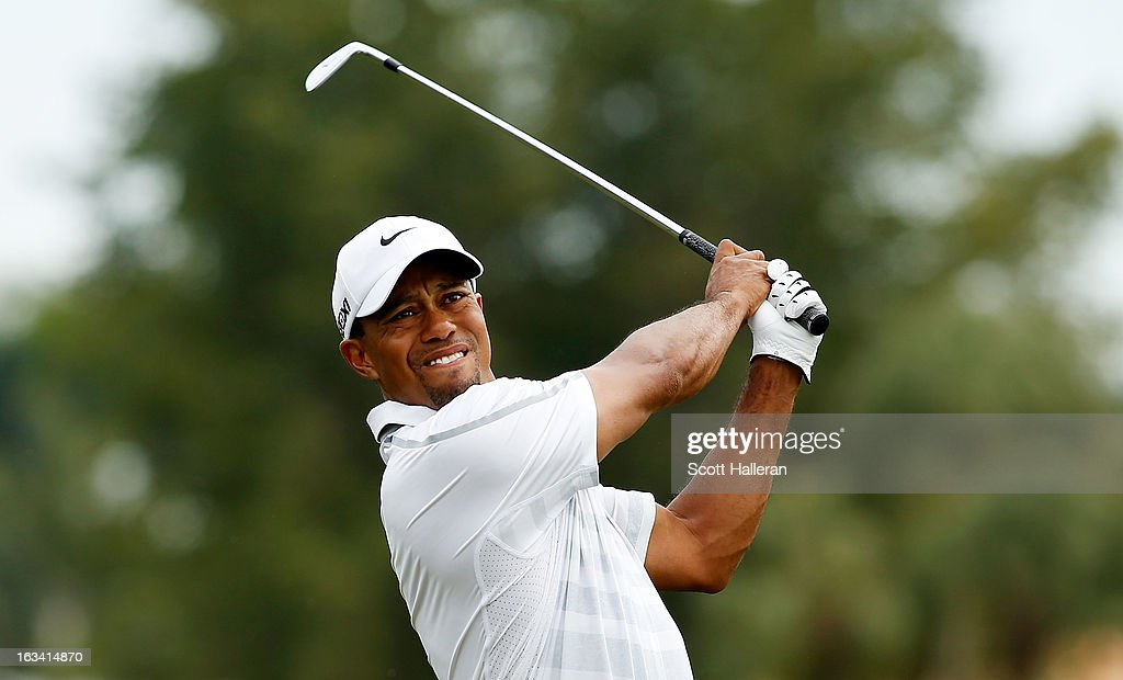Tiger Woods watches his approach shot on the first hole during the third round of the World Golf Championships-Cadillac Championship at the Trump Doral Golf Resort & Spa on March 9, 2013 in Doral, Florida.