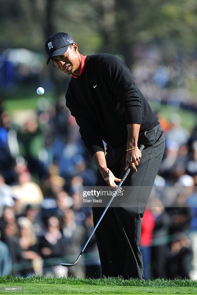 Tiger Woods watches his chip shot on the 12th hole during the final round of the Farmers Insurance Open at Torrey Pines Golf Course on January 28, 2013 in La Jolla, California.