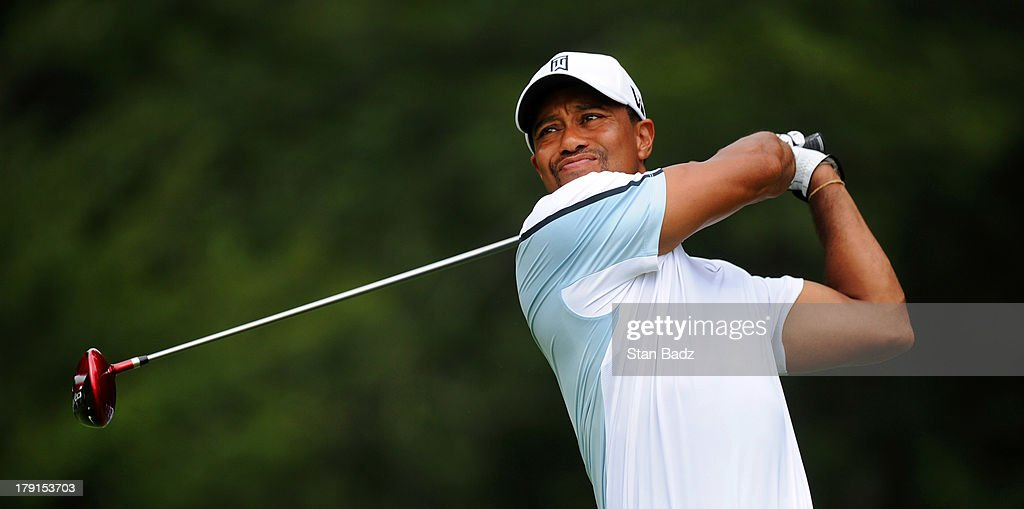 <a gi-track='captionPersonalityLinkClicked' href=/galleries/search?phrase=Tiger+Woods&family=editorial&specificpeople=157537 ng-click='$event.stopPropagation()'>Tiger Woods</a> watches his drive on the fourth hole during the second round of the Deutsche Bank Championship at TPC Boston on August 31, 2013 in Norton, Massachusetts.