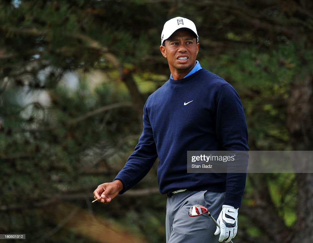 Tiger Woods watches his drive on the fourth hole during the second round of the BMW Championship at Conway Farms Golf Club on September 13, 2013 in Lake Forest, Illinois.