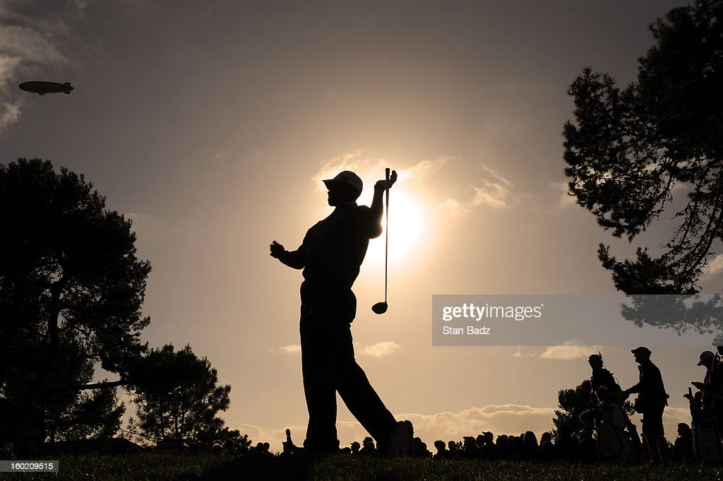 Tiger Woods watches his drive on the second hole during the final round of the Farmers Insurance Open at Torrey Pines Golf Course on January 27, 2013 in La Jolla, California.