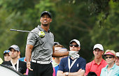 Tiger Woods watches his errant tee shot on the seventh hole during the second round of the Hero World Challenge at the Isleworth Golf Country Club on...
