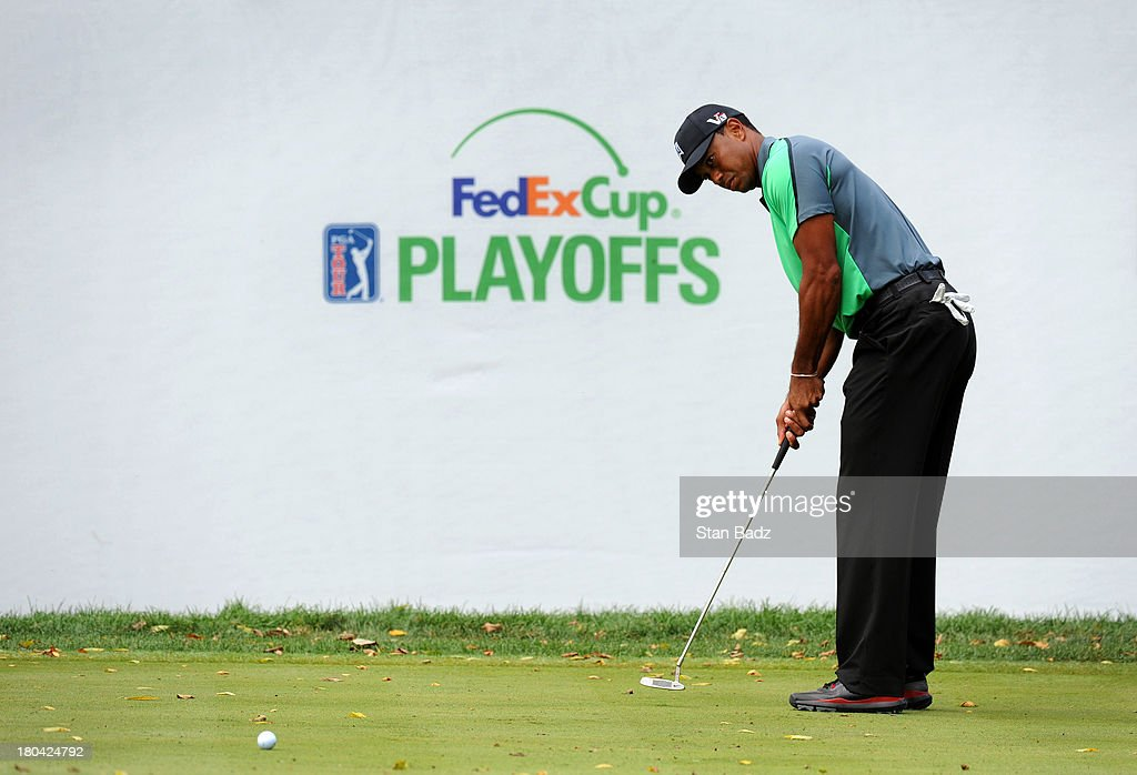 Tiger Woods watches his putt on the ninth hole during the first round of the BMW Championship at Conway Farms Golf Club on September 12, 2013 in Lake Forest, Illinois.