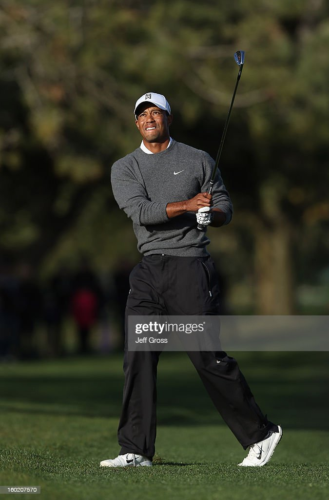 Tiger Woods watches his second shot on the second hole during the final round of the Farmers Insurance Open at at Torrey Pines South Golf Course on January 27, 2013 in La Jolla, California.