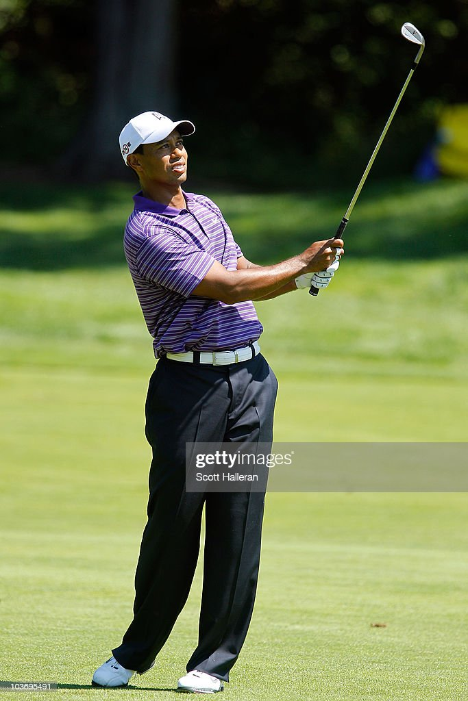 Tiger Woods watches his shot from the fairway on the third hole during the third round of The Barclays at the Ridgewood Country Club on August 28...
