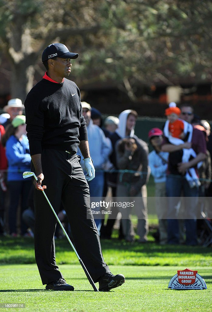 Tiger Woods watches his tee shot on the 11th hole during the final round of the Farmers Insurance Open at Torrey Pines Golf Course on January 28, 2013 in La Jolla, California.