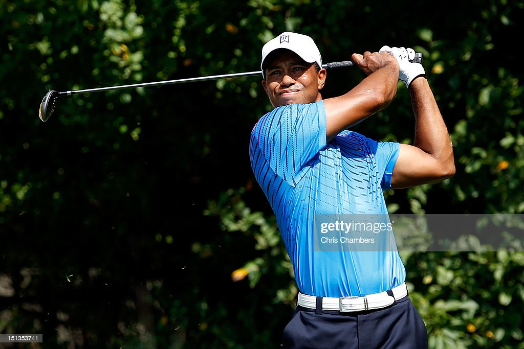 <a gi-track='captionPersonalityLinkClicked' href=/galleries/search?phrase=Tiger+Woods&family=editorial&specificpeople=157537 ng-click='$event.stopPropagation()'>Tiger Woods</a> watches his tee shot on the 12th hole during the first round of the BMW Championship at Crooked Stick Golf Club on September 6, 2012 in Carmel, Indiana.