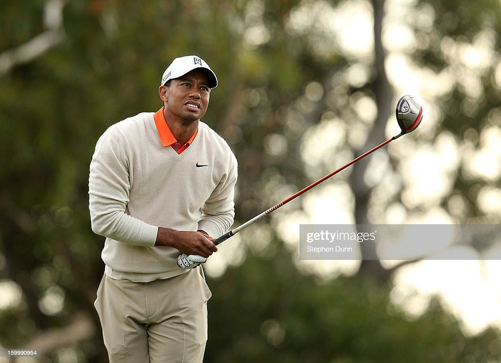 Tiger Woods watches his tee shot on the 15th hole during the first round of the Farmers Insurance Open on the South Course at Torrey Pines Golf Course on January 24, 2013 in La Jolla, California.