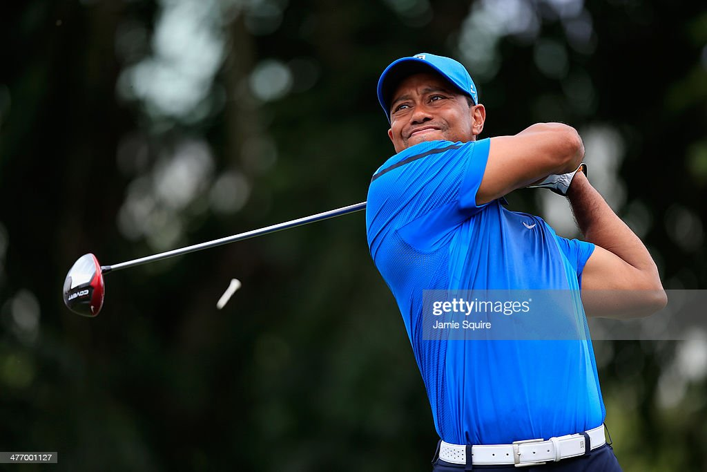 <a gi-track='captionPersonalityLinkClicked' href=/galleries/search?phrase=Tiger+Woods&family=editorial&specificpeople=157537 ng-click='$event.stopPropagation()'>Tiger Woods</a> watches his tee shot on the seventh hole during the first round of the World Golf Championships-Cadillac Championship at Trump National Doral on March 6, 2014 in Doral, Florida.