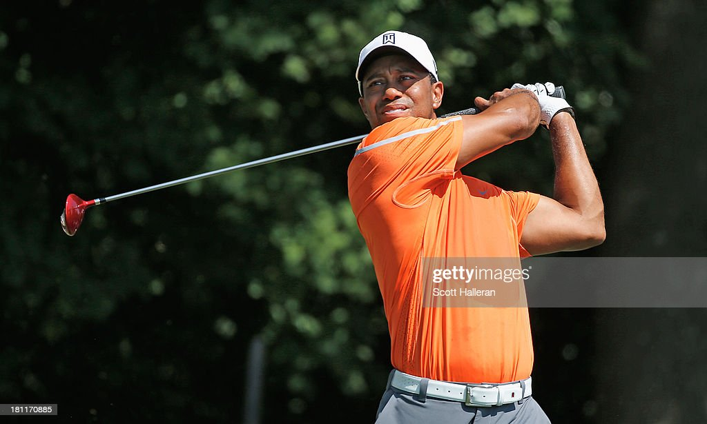 <a gi-track='captionPersonalityLinkClicked' href=/galleries/search?phrase=Tiger+Woods&family=editorial&specificpeople=157537 ng-click='$event.stopPropagation()'>Tiger Woods</a> watches his tee shot on the third hole during the first round of the TOUR Championship by Coca-Cola at East Lake Golf Club on September 19, 2013 in Atlanta, Georgia.
