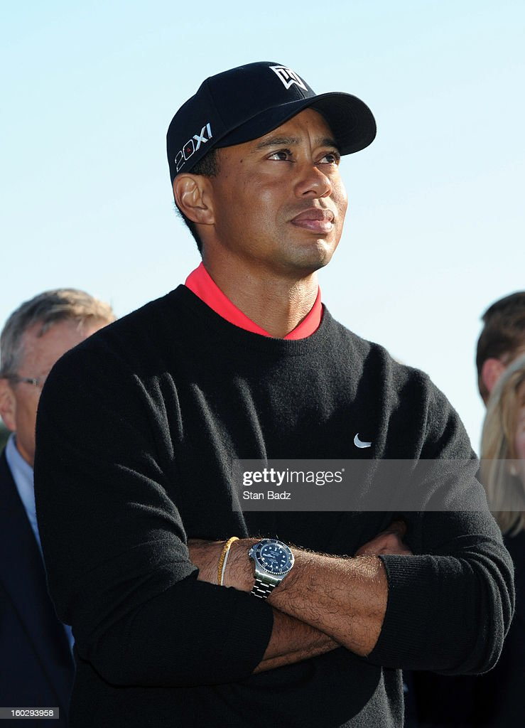 Tiger Woods watches jet fighters fly over head on the 18th hole during the final round of the Farmers Insurance Open at Torrey Pines Golf Course on January 28, 2013 in La Jolla, California.