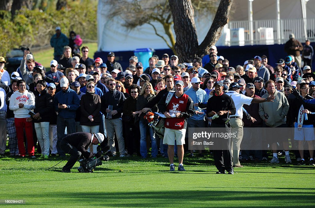 Tiger Woods watches play from the 18th fairway during the final round of the Farmers Insurance Open at Torrey Pines Golf Course on January 28, 2013 in La Jolla, California.