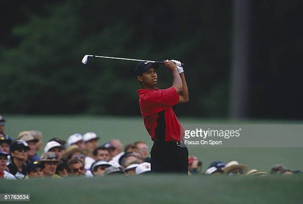 Tiger Woods watches the flight of his ball during the Masters Tournament at the Augusta National Golf Club on April 13 1997 in Augusta Georgia Tiger...