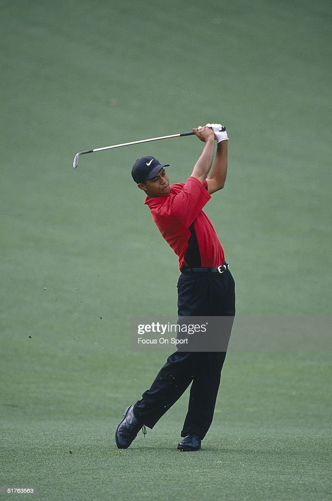Tiger Woods watches the flight of his ball during the Masters Tournament at the Augusta National Golf Club on April 13, 1997 in Augusta, Georgia. Tiger Woods won the Masters with a 18 under par.