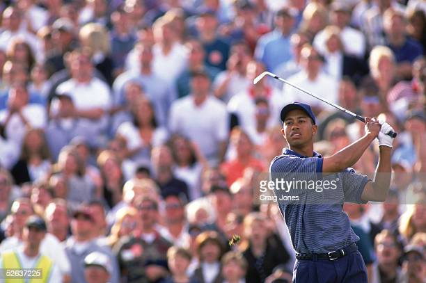 Tiger Woods watches the flight of the ball as he follows through on his swing on the sixteenth hole during the Phoenix Open at the Tournament Players...