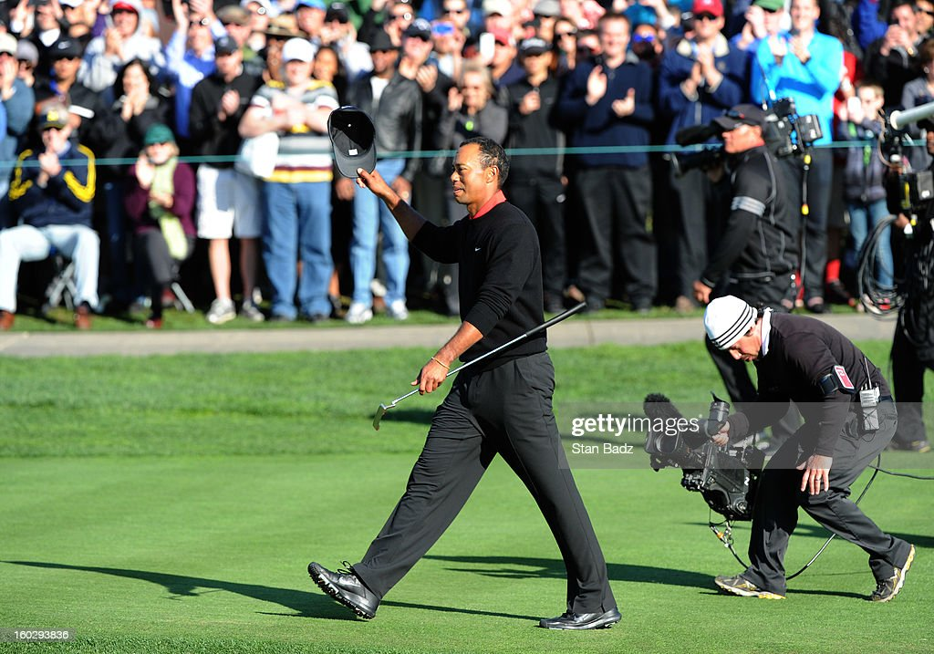 Tiger Woods waves his cap as he walks to the 18th green during the final round of the Farmers Insurance Open at Torrey Pines Golf Course on January 28, 2013 in La Jolla, California.