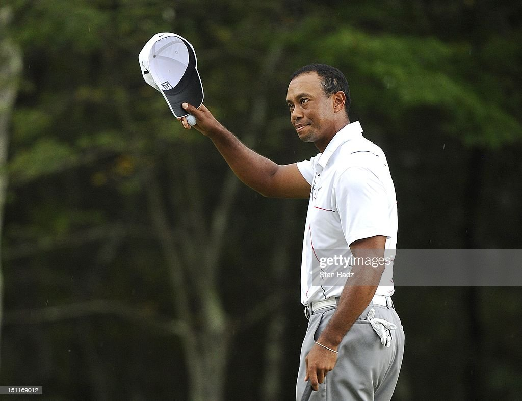 <a gi-track='captionPersonalityLinkClicked' href=/galleries/search?phrase=Tiger+Woods&family=editorial&specificpeople=157537 ng-click='$event.stopPropagation()'>Tiger Woods</a> waves his cap to the gallery on the 18th hole during the third round of the Deutsche Bank Championship at TPC Boston on September 2, 2012 in Norton, Massachusetts.
