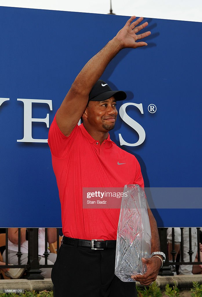Tiger Woods waves to fans during the trophy ceremony after the final round of THE PLAYERS Championship on THE PLAYERS Stadium Course at TPC Sawgrass on May 12, 2013 in Ponte Vedra Beach, Florida.