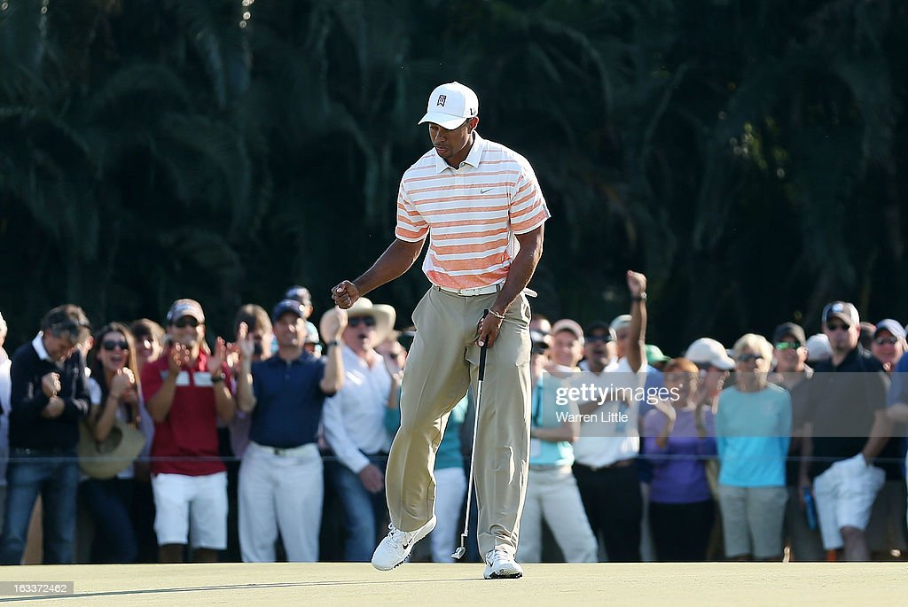 Tiger Woods waves to the gallery after making birdie on the 13th green during the second round of the World Golf Championships-Cadillac Championship at the Trump Doral Golf Resort & Spa on March 8, 2013 in Doral, Florida.
