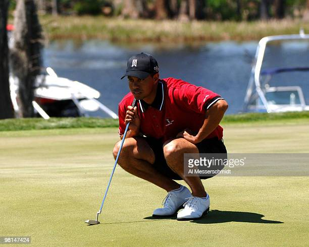 Tiger Woods wearing shorts lines up a putt on the second hole during competition in the 2005 Tavistock Cup at Isleworth Country Club March 29