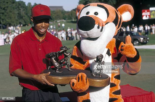 Tiger Woods with trophy at the 1996 Walt Disney World/Oldsmobile Classic October 1996