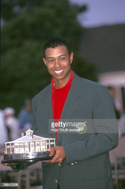 Tiger Woods with trophy at the 1997 Masters Tournament at the Augusta National Golf Club in Augusta Georgia April 1997
