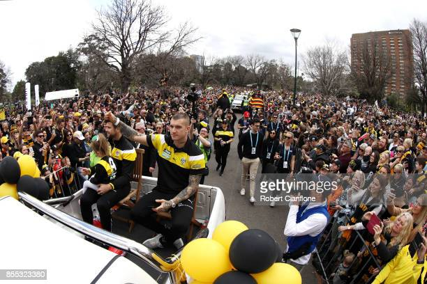 Tigers captain Trent Cotchin and Dustin Martin of the Tigers wave to fans during the 2017 AFL Grand Final Parade ahead of the Grand Final between the...